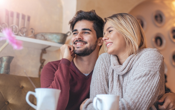 Beautiful young couple sitting in a cafe - What Does A Taurus Man Like About A Pisces Woman