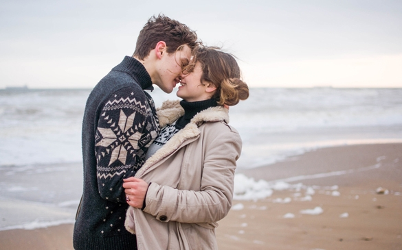 Young cute couple at sea in winter - What Does A Taurus Man Like About A Pisces Woman
